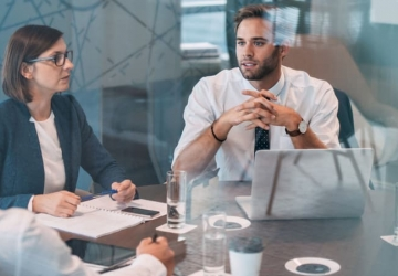 A data analyst advising his colleagues at an executive board meeting.